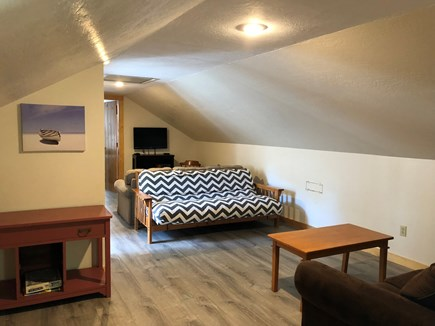 Harwich Cape Cod vacation rental - Upstairs Living Area with TV located between bedrooms 5 & 6