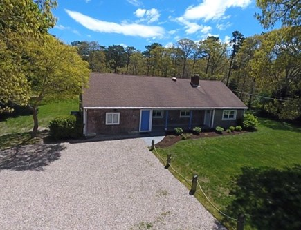 Harwich Cape Cod vacation rental - Front view of home with driveway for ample parking.