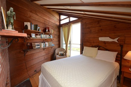 Orleans Cape Cod vacation rental - Master bedroom with sliding door opening to deck.