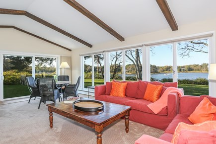 East Orleans Cape Cod vacation rental - Big living room with water views and pool views from every window