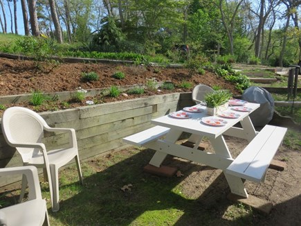 Eastham Cape Cod vacation rental - Outdoor back tiered garden area for grilling and dining