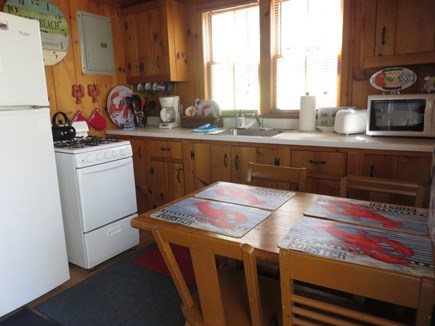 Eastham Cape Cod vacation rental - Knotty pine kitchen with hardwood floors and all the conveniences