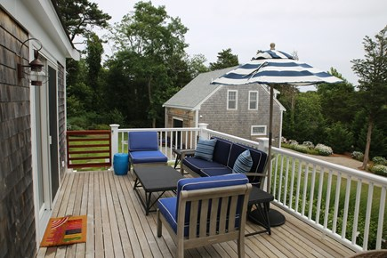 East Orleans, Mill Pond  Cape Cod vacation rental - Mahogany Deck overlooking pool and Boat House, Lounge Area