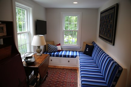 East Orleans, Mill Pond  Cape Cod vacation rental - TV room off Kitchen and Great Room with glass barn door