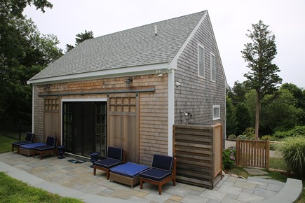 East Orleans, Mill Pond  Cape Cod vacation rental - Boat House, bluestone patio w/seating, stone wall
