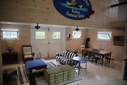 East Orleans, Mill Pond  Cape Cod vacation rental - Boathouse First Floor Sitting and Dining Area w/propane stove