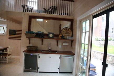 East Orleans, Mill Pond  Cape Cod vacation rental - Boathouse with beverage refrigerator, sink, and dishwasher