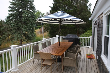 East Orleans, Mill Pond  Cape Cod vacation rental - Dining on the mahogany deck, seating 8-10