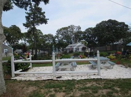 Dennisport Cape Cod vacation rental - Shared picnic area to enjoy lunch or dinner by the pool.