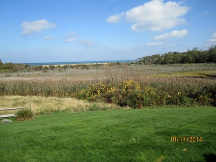 Brewster Cape Cod vacation rental - The view of the Bay from the living room, sun porch or rear deck