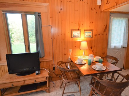 Orleans Cape Cod vacation rental - Dining area with TV and access to backyard