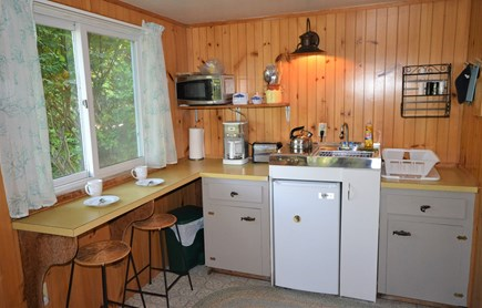 Orleans Cape Cod vacation rental - Kitchen with breakfast nook overlooking backyard