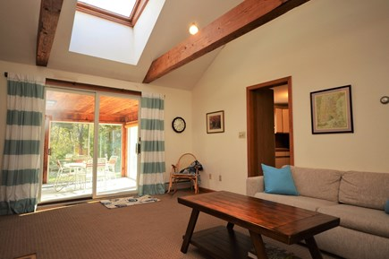 Orleans Cape Cod vacation rental - Cozy living room with lots of natural light & access to sun room