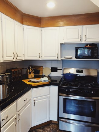 Eastham Cape Cod vacation rental - Kitchen with gas stove/over, microwave, toaster, etc.