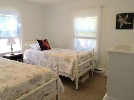North Falmouth Cape Cod vacation rental - 2nd bedroom with 2 twin beds washer and dryer in closet