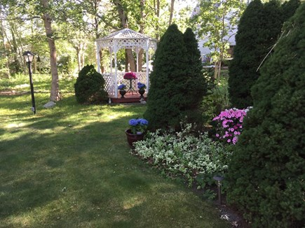 North Falmouth Cape Cod vacation rental - Enjoy the peaceful setting of the back yard.