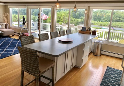 Falmouth Cape Cod vacation rental - Eat in Kitchen & FR, open floor plan with wall to wall windows.