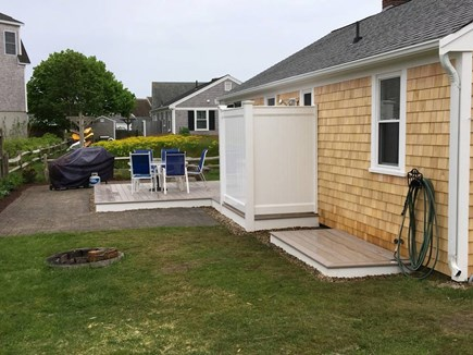 West Dennis Cape Cod vacation rental - Back of home showing Deck, Outdoor shower, toy deck,  foot wash
