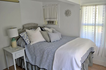 East Orleans Cape Cod vacation rental - Light-filled bedroom with windows on two sides and a closet.