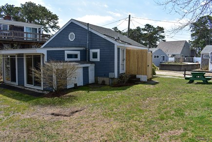 Dennisport Cape Cod vacation rental - Large spacious yard with outside shower.  Parking for 3 vehicles