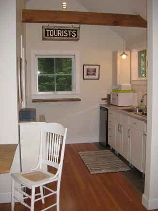 Truro Center Cape Cod vacation rental - Kitchen area including cooktop, oven microwave & fridge