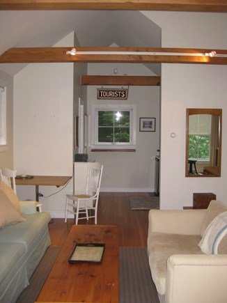 Truro Center Cape Cod vacation rental - Open sitting area with large comfortable sofa for relaxing