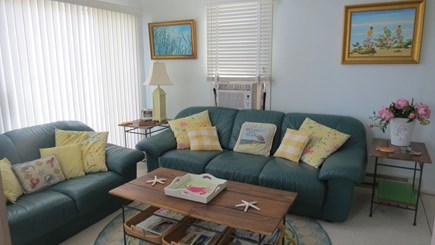 Dennis Cape Cod vacation rental - Bunk house living room- two sofas and television.