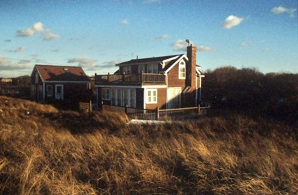 Dennis Cape Cod vacation rental - View of home from the beach and sheltered by dunes.