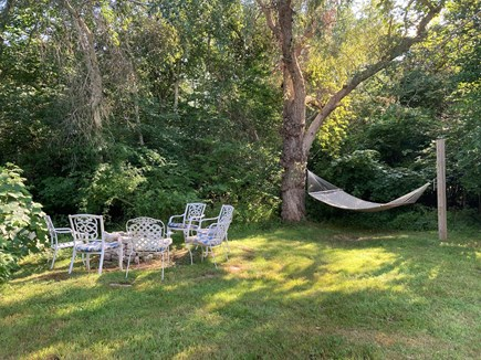 Brewster Cape Cod vacation rental - Hammock and fire pit in the backyard