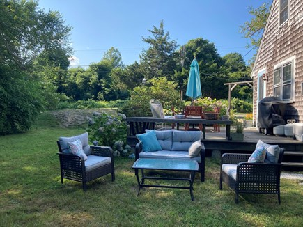 Brewster Cape Cod vacation rental - Backyard patio area looks out to  conservation woods