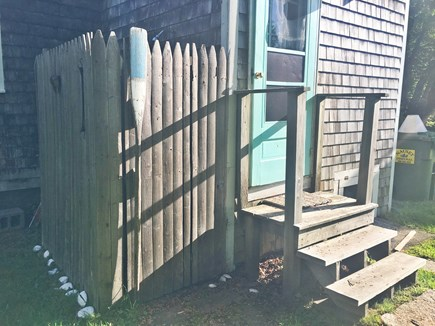 Brewster Cape Cod vacation rental - Outdoor shower and coffee stoop looks out to the backyard woods.