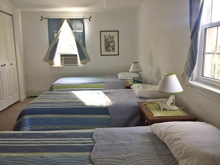 Harwich Cape Cod vacation rental - This is a great room for the kids--3 twin beds, AC unit & a TV.