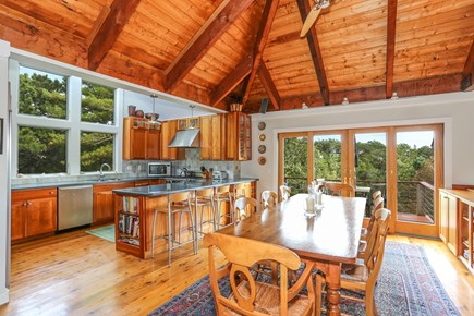 TRURO Cape Cod vacation rental - Kitchen and Dining Opens to Deck with Grille, Table and Seating