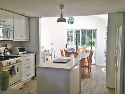 Harwich Port Cape Cod vacation rental - Kitchen and dining area with sliders to the deck