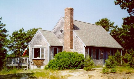 Wellfleet Cape Cod vacation rental - Front and side of house w/ parking & deck