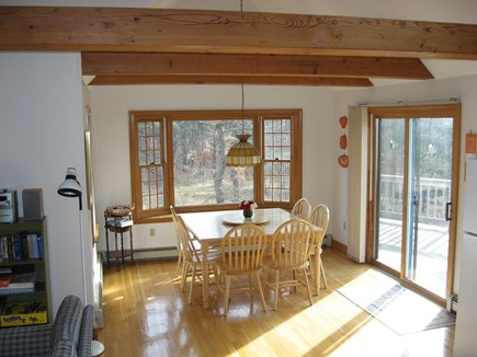 Wellfleet Cape Cod vacation rental - Dining area w/ open beams below cathedral ceiling, slider to deck