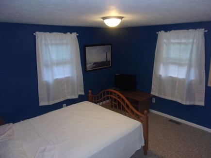 Eastham Cape Cod vacation rental - Master bedroom with Queen Bed, DVD player, TV and DVDs