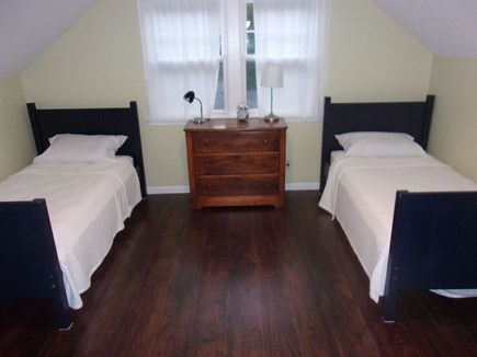 Eastham Cape Cod vacation rental - Upstairs bedroom 2 with 2 twin beds and floor-level pullout couch