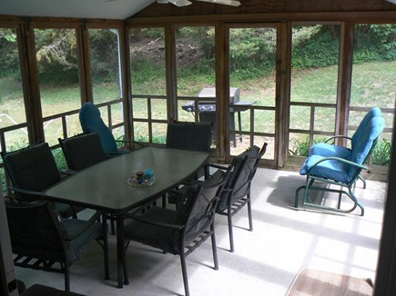 East Orleans Cape Cod vacation rental - Large screened porch w/gas grill. Porch has ceiling fan w/lights.