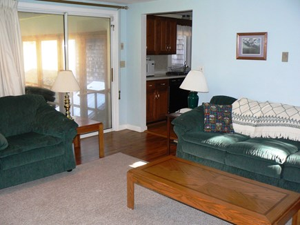 East Orleans Cape Cod vacation rental - Comfortable living room has slider to screened-in porch.