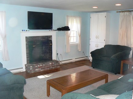 East Orleans Cape Cod vacation rental - High-def cable TV sits above fireplace with DVD player.