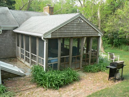 East Orleans Cape Cod vacation rental - Spacious screened-in porch with dining table.