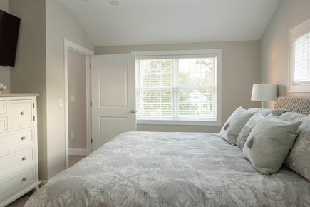 Dennis, Mayflower Beach Cape Cod vacation rental - Second Floor Master Bedroom #1 with King Bed,TV & Bathroom
