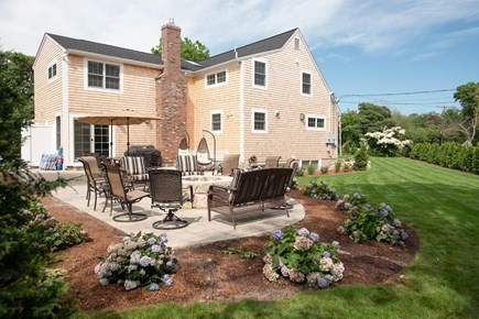 Dennis, Mayflower Beach Cape Cod vacation rental - Back of house with Firepit, Grill & Seating for 20