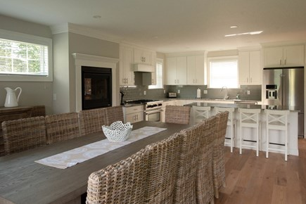 Dennis, Mayflower Beach Cape Cod vacation rental - First Floor Kitchen & Dining Room with Gas Fireplace