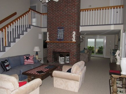 Falmouth Cape Cod vacation rental - Skylit living room with floor to ceiling fireplace