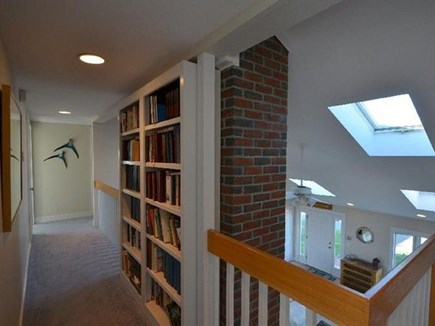 Falmouth Cape Cod vacation rental - Upstairs hall with vintage book collection