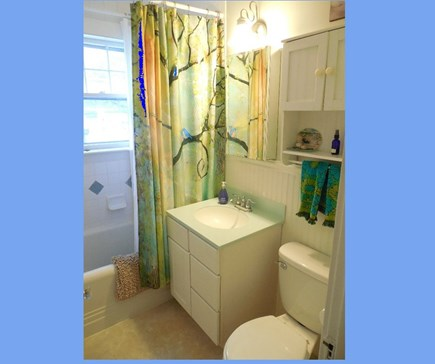 West Yarmouth Cape Cod vacation rental - The bathroom has a tub/shower.