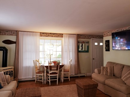Dennisport Cape Cod vacation rental - Living room/ 40 in. Smart TV to stream TV and News + 100 DVDs
