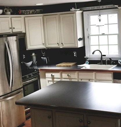 Dennisport Cape Cod vacation rental - Kitchen with new appliances and basin sink ideal for lobster bake